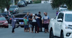 People comfort each other at the scene of a fatal stabbing in South Granville.