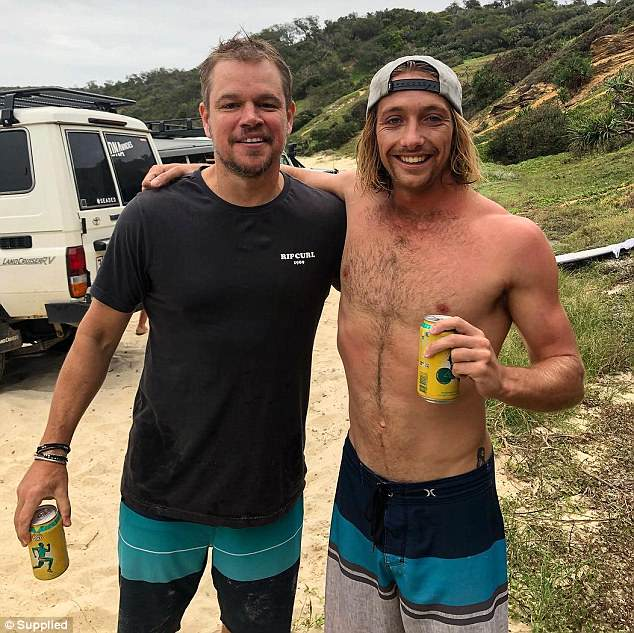 Two tinnies: A source recently told Woman's Day that Matt is envious of Chris Hemsworth's laid-back lifestyle Down Under. Pictured at Double Island Point with local surfer Tyler Boyce