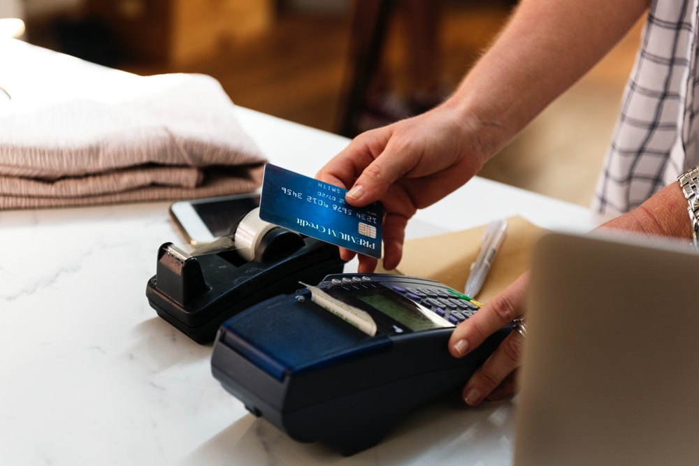 person holding blue card