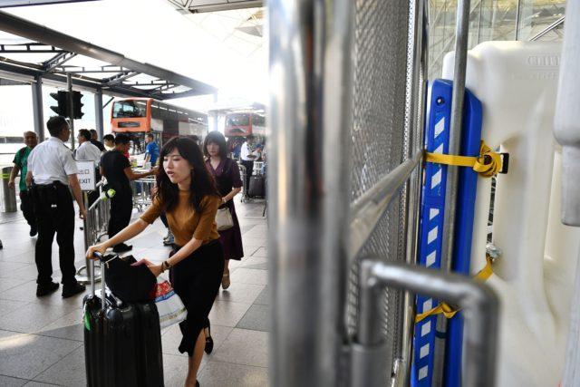 香港人入境大陸被嚴格檢查(圖片來源: ANTHONY WALLACE/AFP via Getty Images)