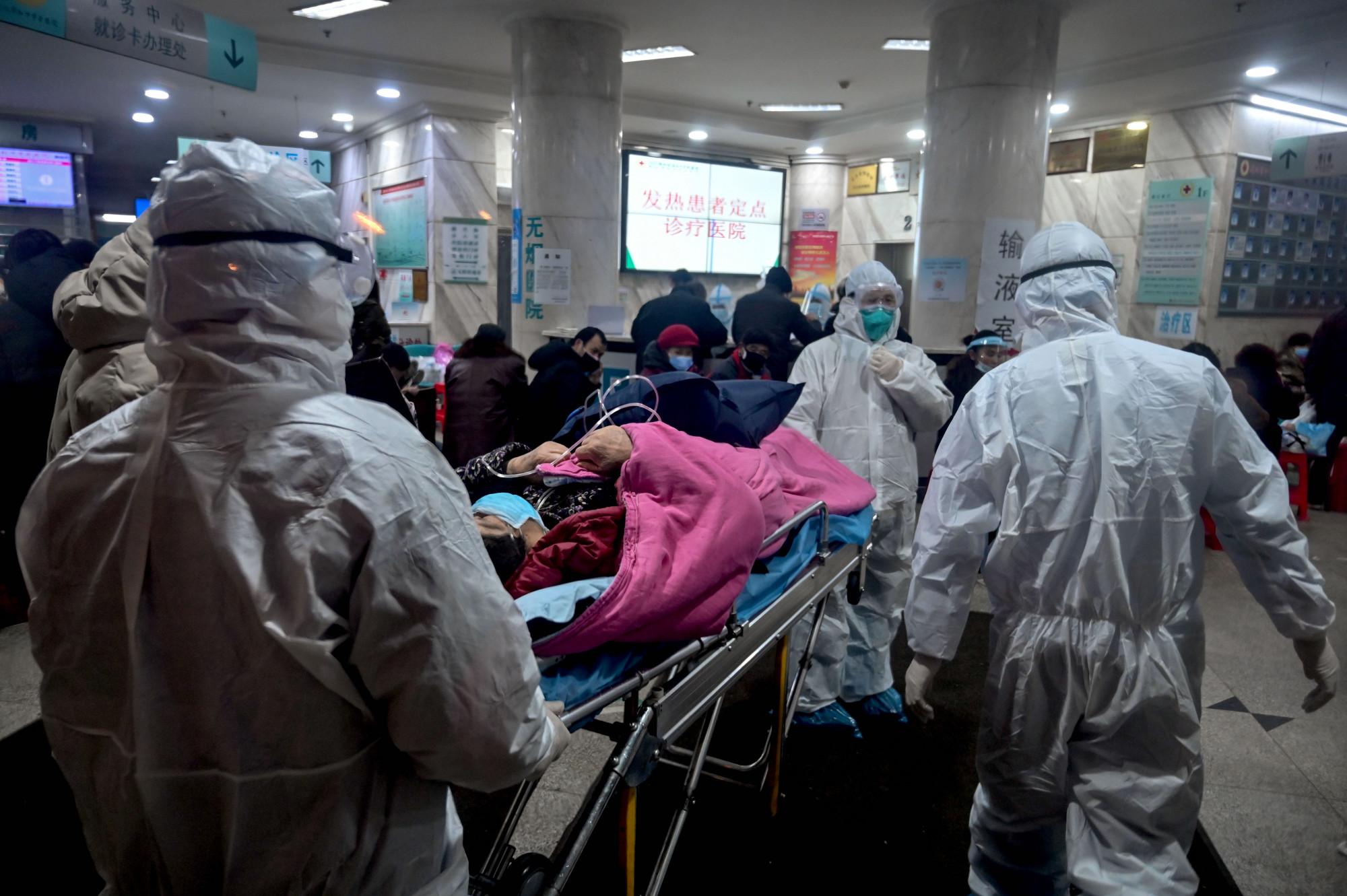 武汉一家医院正在处理肺炎患者。(图片来源:HECTOR RETAMAL/AFP via Getty Images)